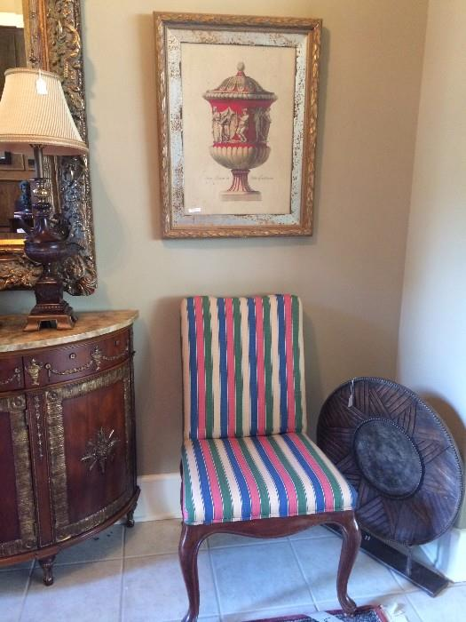 One of two striped chairs; one of two framed urns