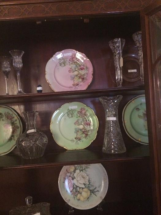 Crystal and pressed glass pitchers; floral china plates