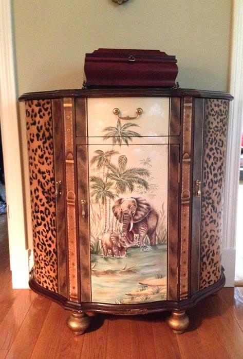 African themed demilune cabinet
