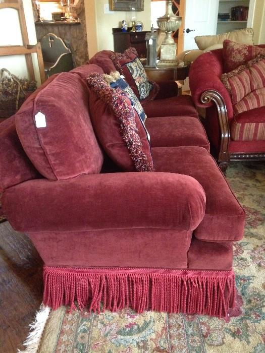 One of the two red sofas