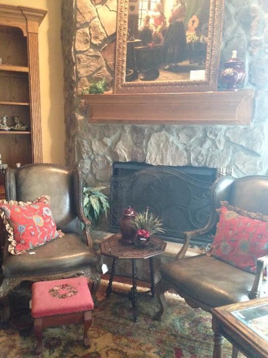 Leather chairs; needlepoint foot stool; large framed art