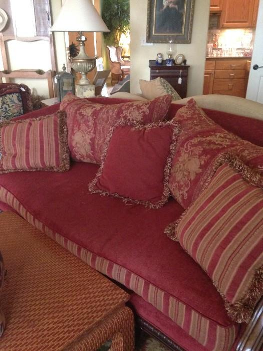 The other red sofa; decorative pillows