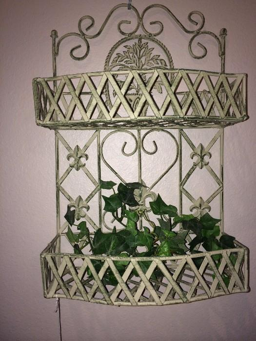 One of two iron wall shelves