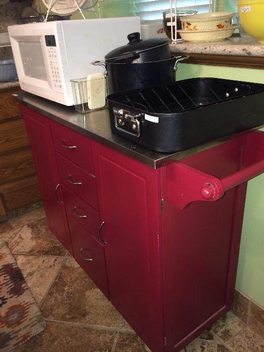Red cabinet on wheels - great for an island