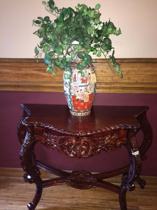 Ornate entry table; Asian vase
