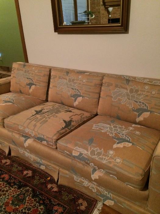 Three cushioned sofa