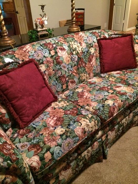 Floral sofa has matching love seat.