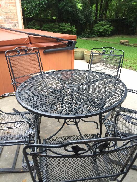 Black round table with 5 spring chairs