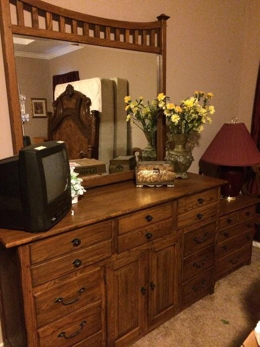 Rustic style dresser has matching armoire & nightstand.