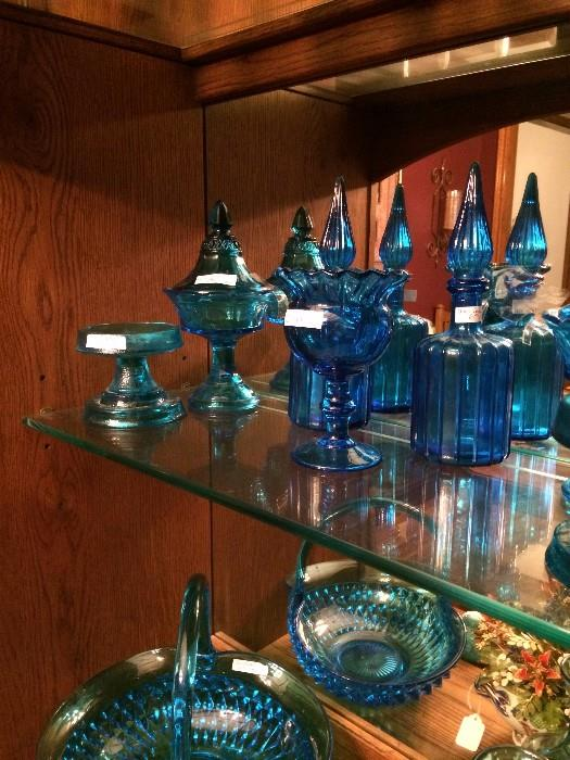 Lots of blue baskets, bowls, & decanters