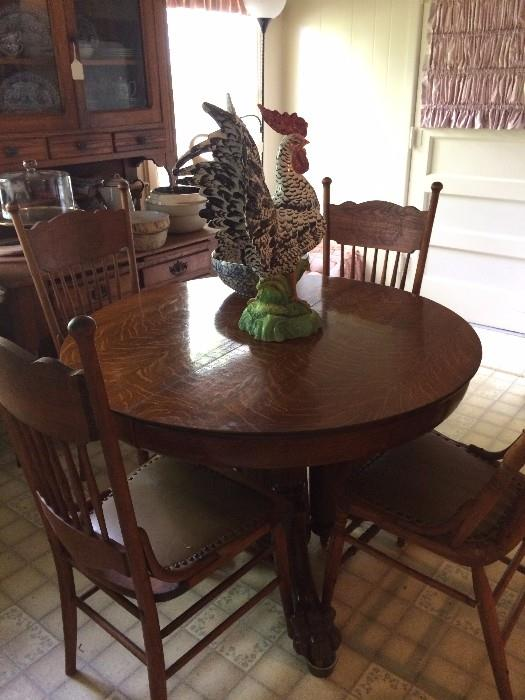 Claw foot antique oak table & chairs; one of the many roosters