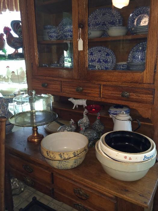 Antique cupboard with a variety of dishes
