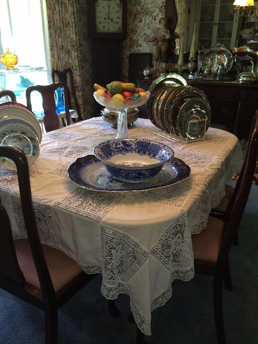 Antique dining table & 8 Queen Anne chairs; many blue & white bowls & plates