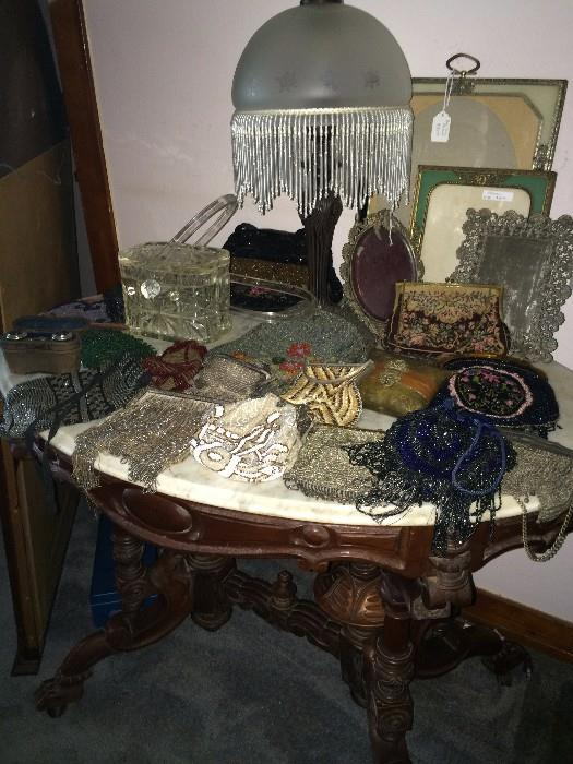 Victorian lamp; vintage beaded purses; oval marble top beautifully carved table