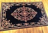 larger plush wool rug black and gold