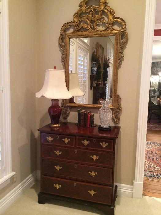 Five drawer chest and gold decorative mirror