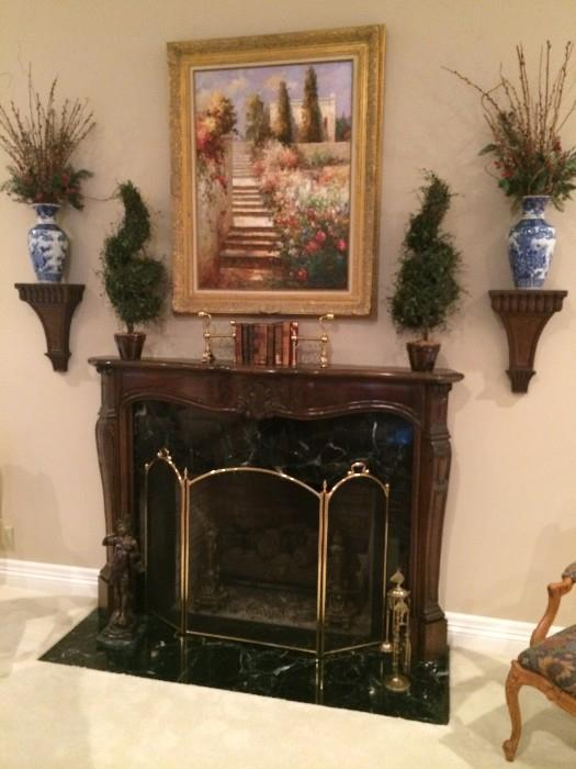 Wall sconces and some of the numerous pieces of framed art and decorative items