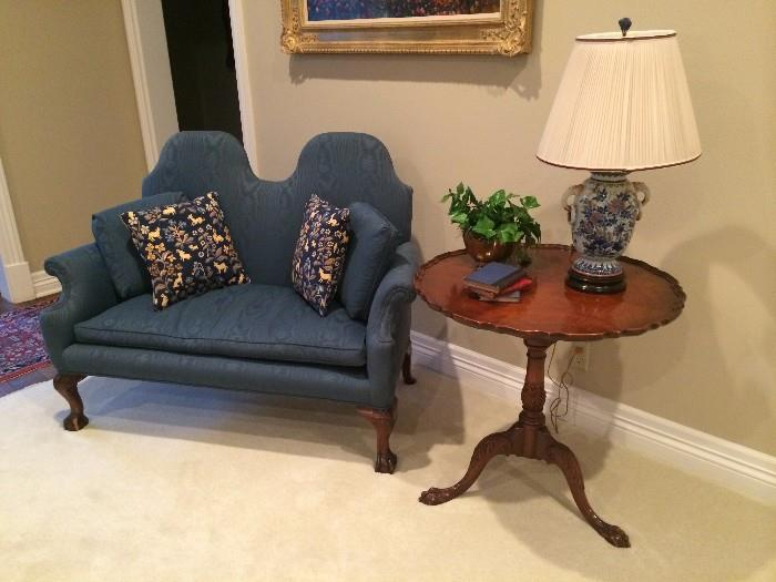 Rare double hump back Chippendale settee; pie crust side table; some of the many lamps and decorative accessories