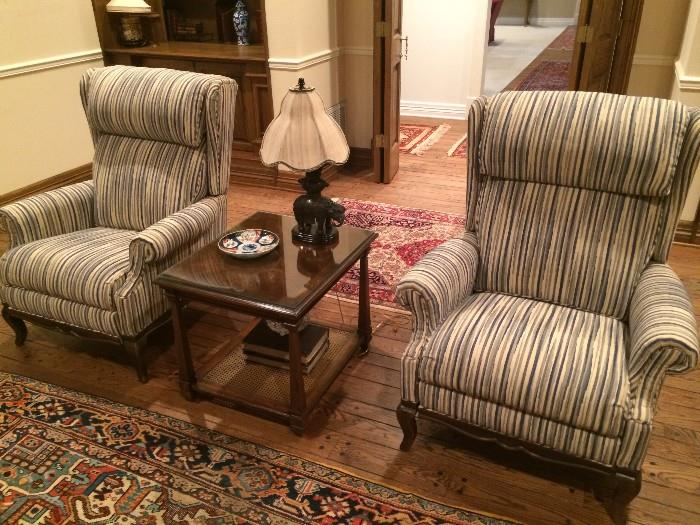 Extra comfortable striped recliners; side table; rugs