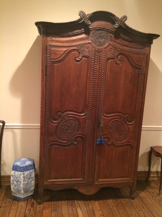 Detailed antique armoire; blue & white garden stool