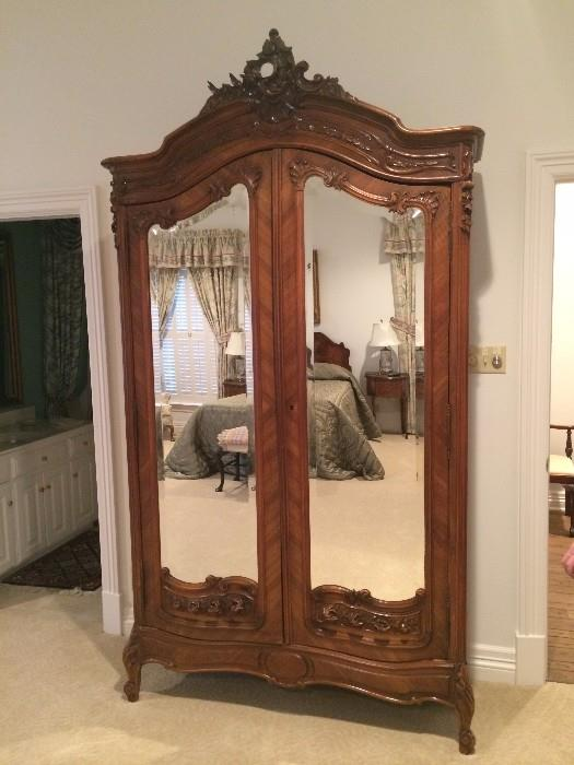 The extra large antique armoire can be used for storage or as an entertainment unit.