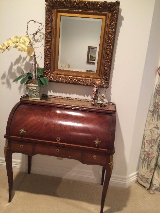 Elegant roll-top desk, mirror, and other decor