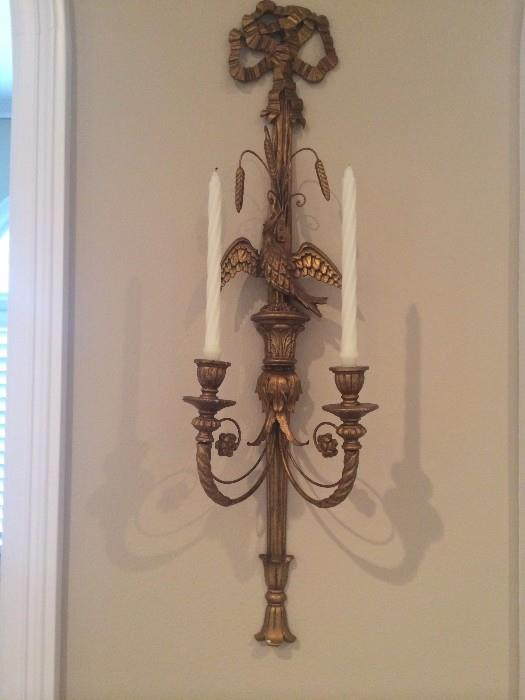 One of two matching wall sconces