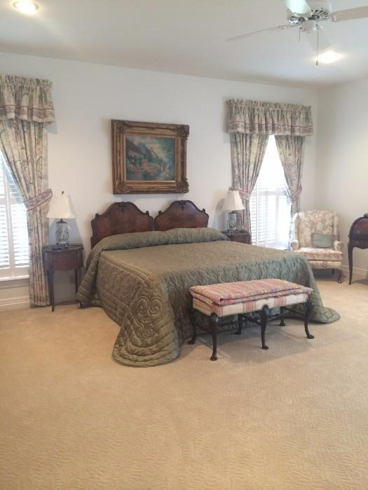 The lovely guest room is host to a beautifully burled wood king bed & oval shaped side tables.