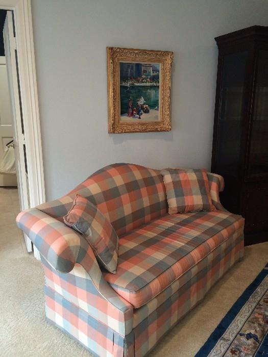 This plaid love seat has matching chair.