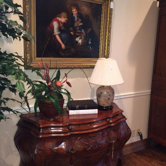 Bombay chest, decorative items, and painting of children
