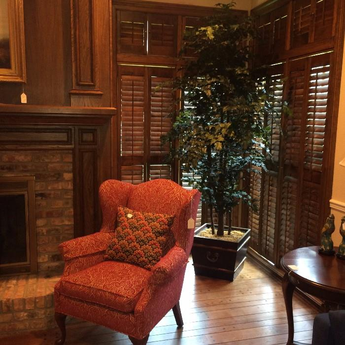 Fireside chair; large artificial plant