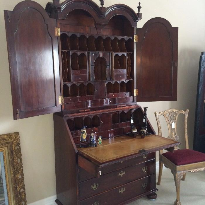 Secretary with leather top writing surface and more that enough storage sections