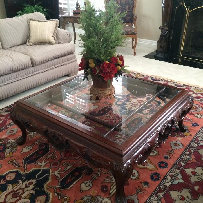 One of the many fine rugs, tables, and floral arrangements