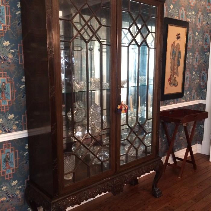 Gorgeous display china cabinet with beautiful  crystal and cut glass; butler's tray; one of two Asian framed Geisha girls.