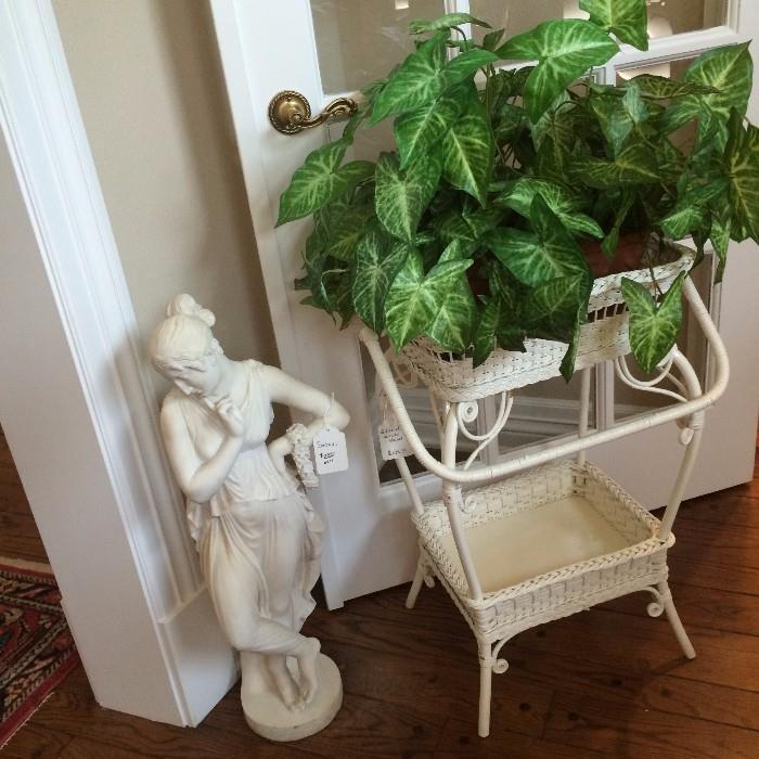Statue of a lady; white wicker 2-tier planter