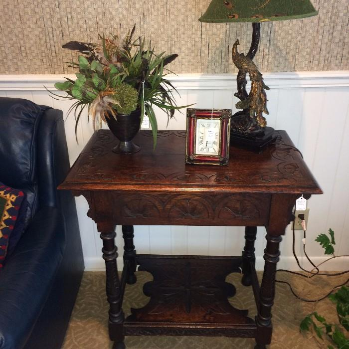Intricately carved 2-tier English table