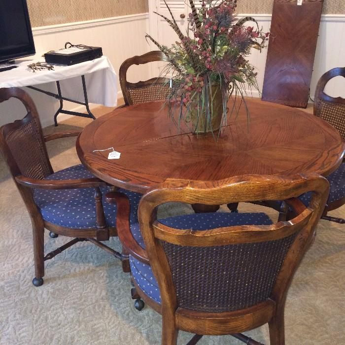 Great game table with four chairs on casters
