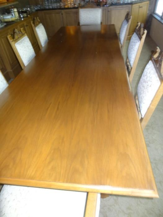 """Huge Beautiful Dining Room Table measures 10' Long by 42"""" wide with 12 chairs & two extensions measuring 27"""" each"""