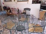 Heavy cast iron table base & 4 chairs w/rush seats & hand painted design