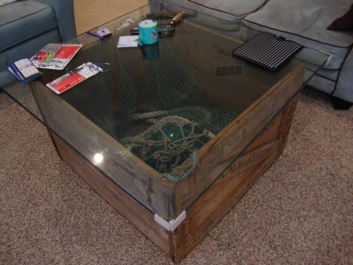 Custom Made Coffee Table from an old crate used to ship merchandise to Murdochs Bath House, includes glass float and netting