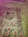There are 2 chain stitch embroidered rugs approx. 9x12