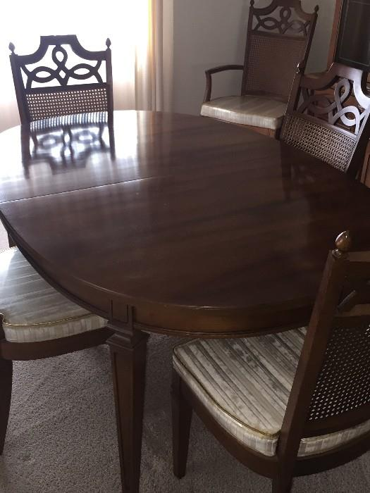 MID-CENTURY OVAL DINING ROOM TABLE WITH CANE BACK CHAIRS
