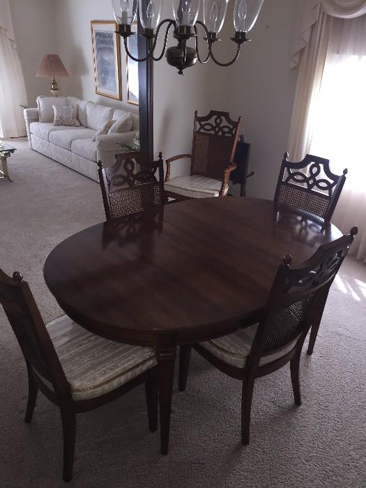 MID-CENTURY SOLID PECAN WOOD DINING ROOM TABLE WITH CANE BACK CHAIRS