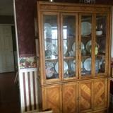 china cabinet has matching table and chairs