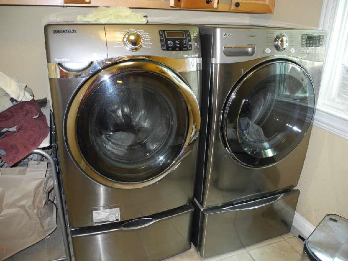 Almost NEW! Stainless washer and dryer plus the stands! Cost $1200 each.