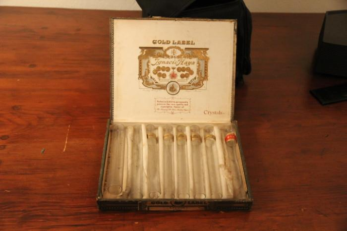 Gold label cigar box with glass tubes