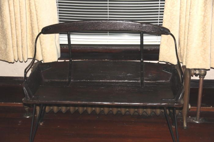 bench made from an antique buckboard seat