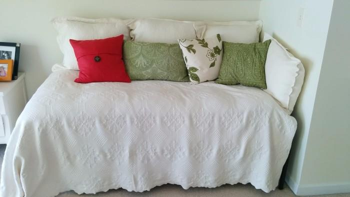 Lovely day bed, with jaunty pillows atop a crispy, white matelasse spread.                                                              You can create your very own beach cottage vignette, with all your children dressed in white shirts and khakis - very J. Crew!