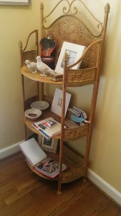 Metal bathroom etagere for soft and pretty things - towels, TP, pics of relatives in white shirts and khakis, People magazines, gentleman's magazines - just in case.