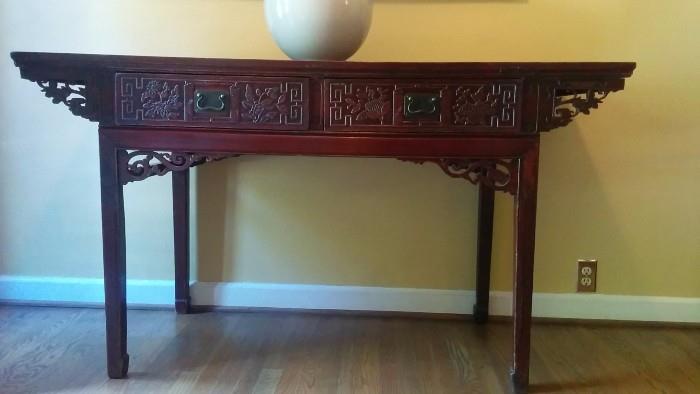 Asian-y mahogany console table.